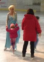Elsa guides skater